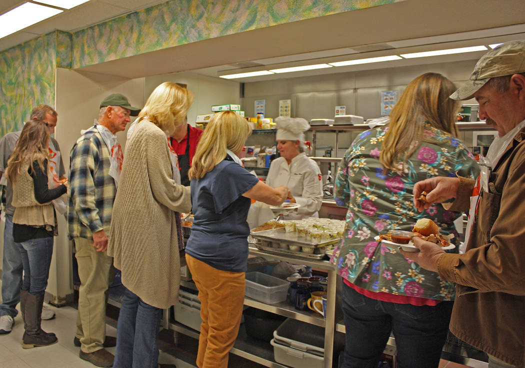 Robin Hebrock/Pahrump Valley Times Crab Fest goers line up in eager anticipation of a feast featuring not just crab but chicken and plenty of sides.