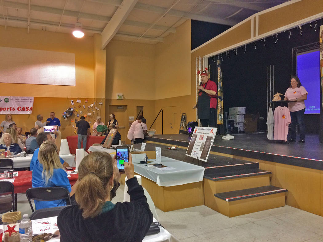 Robin Hebrock/Pahrump Valley Times CASA Executive Director Kathie McKenna, far right, and Crab Fest founder Brian Kunzi, shown wearing his well-known crab hat, addressed the crowd at the 2019 even ...