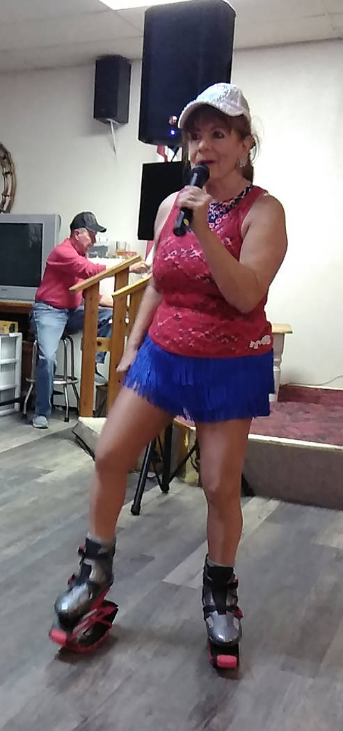 Selwyn Harris/Pahrump Valley Times Teri Rogers, founder of Twilight Productions, performs the classic song 'Oh Susanna,' all while dancing in Kangoo Jump Shoes, during the Pahrump Moose Lodge's sp ...