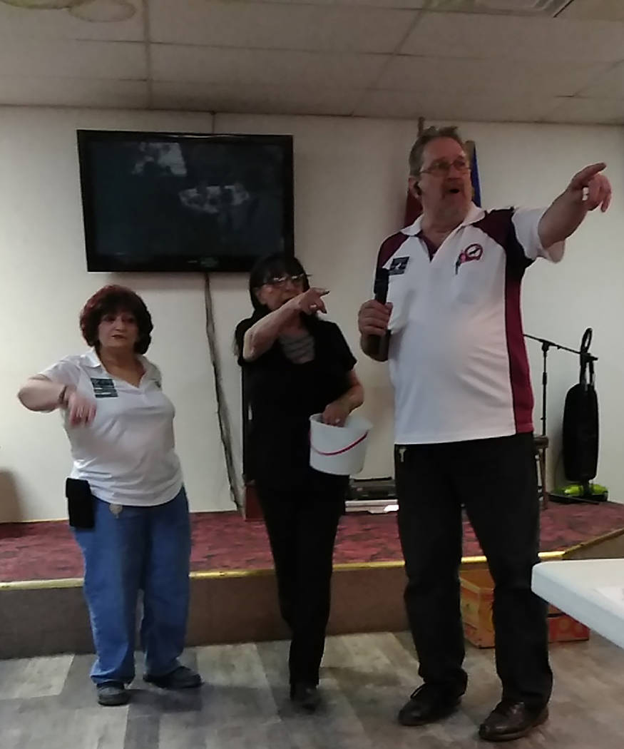 Selwyn Harris/Pahrump Valley Times Pahrump Moose Lodge Governor Tom Trzcinski, right, is joined by Pahrump Senior Center Site Manager Anne Blankenship, center as they look for the winner of the ra ...