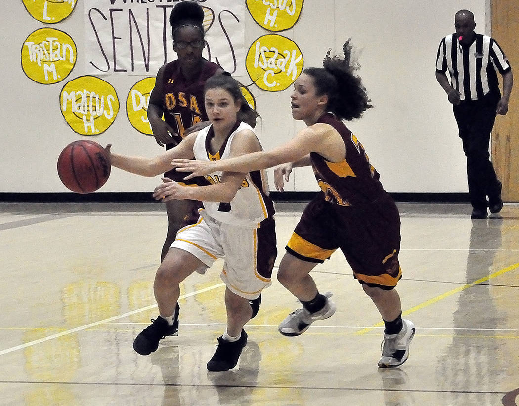 Horace Langford Jr./Pahrump Valley Times Freshman guard Tayla Wombaker brings the ball up the floor for Pahrump Valley during a 57-21 win over Del Sol on Feb. 5. Wombaker was named second-team All ...