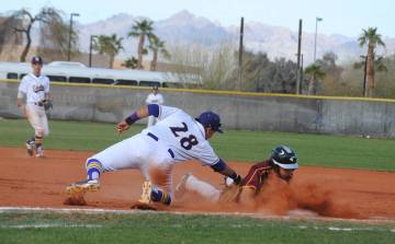 Charlotte Uyeno/Pahrump Valley Times Pahrump Valley's Jalen Denton dives safely back to first base during the Trojans' 5-1 loss to Southwest, California, in the Route 66 Tournament on Saturday in ...