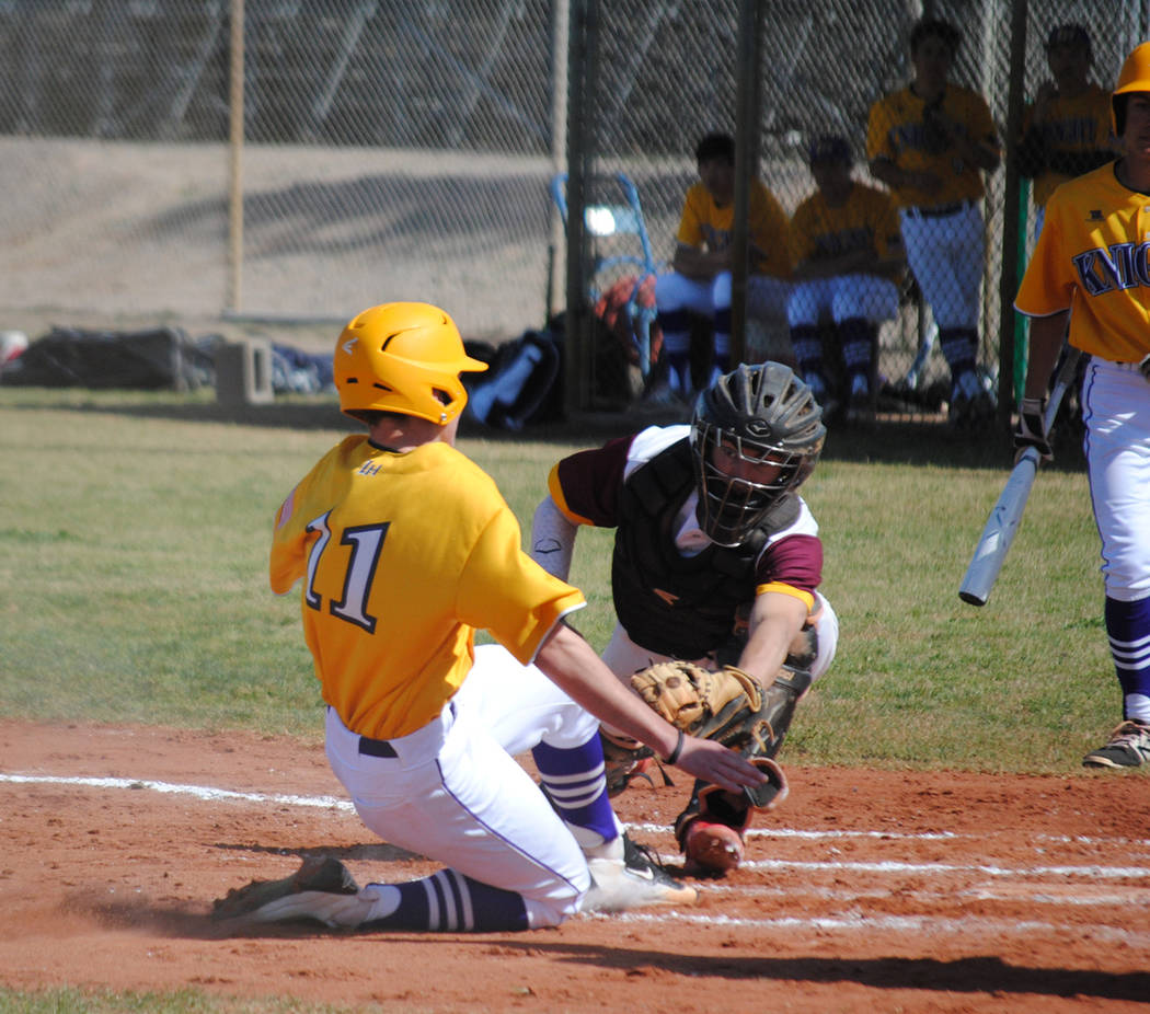 Charlotte Uyeno/Pahrump Valley Times Senior catcher Willie Lucas makes the tag at home to complete a double play on a throw from Chase McDaniel during Pahrump Valley's 12-1 win over Lake Havasu, A ...