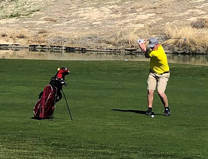 Tom Rysinski/Pahrump Valley Times Koby Lindberg of Pahrump Valley takes his second shot on the 9th hole at Mountain Falls Golf Club on Friday during the second round of the Pahrump Valley Invitati ...