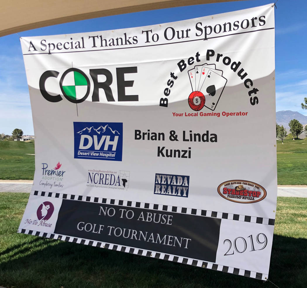 Tom Rysinski/Pahrump Valley Times Sponsors of the annual No To Abuse Golf Tournament are thanked on a banner hung Saturday outside the clubhouse at Mountain Falls Golf Club in Pahrump.
