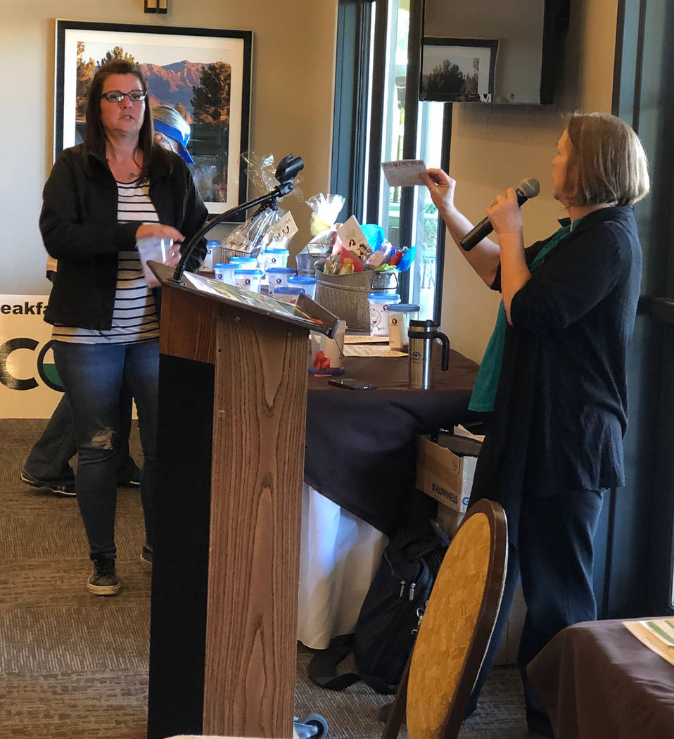 Tom Rysinski/Pahrump Valley Times Kim Taylor, left, and Salli Kerr draw and announce winning raffle tickets Saturday after the No To Abuse Golf Tournament at Mountain Falls Golf Club in Pahrump.