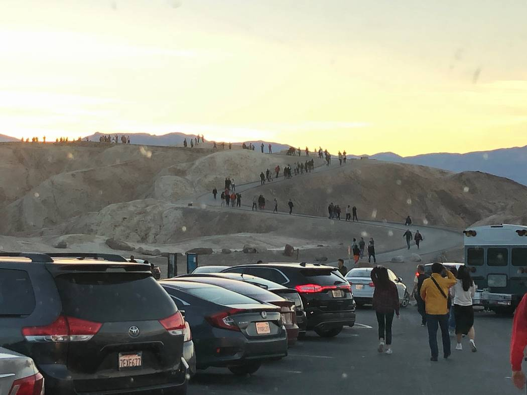 Spencer Solomon /Special to the Pahrump Valley Times Visitors make the trek up the path to the scenic view at Zabriskie Point, one of the most popular attractions in Death Valley.