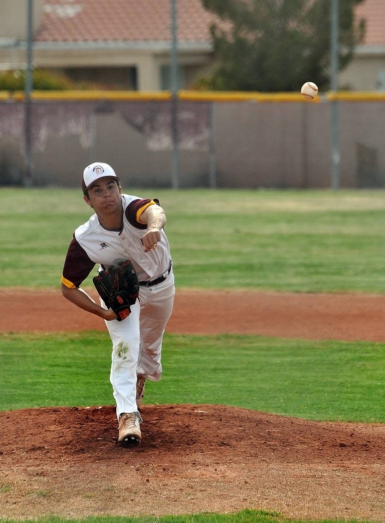 Horace Langford Jr./Pahrump Valley Times Pahrump Valley senior starter Dylan Grossell delivers against Boulder City on Monday in Pahrump. Grossell pitched into the fourth inning of the Trojans' 6- ...