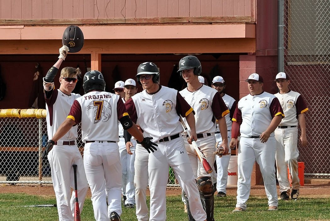 Horace Langford Jr./Pahrump Valley Times Sophomore Jalen Denton is greeted by teammates at home plate after leading off the game with a home run Monday against Boulder City in Pahrump.
