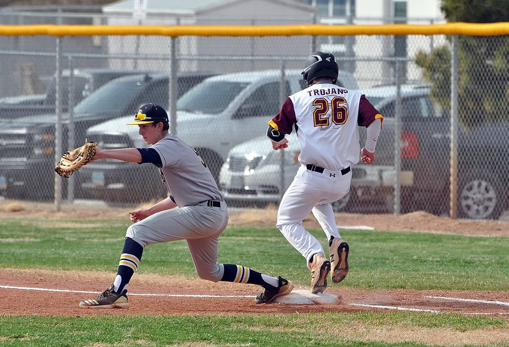Horace Langford Jr./Pahrump Valley Times Pahrump Valley senior Tyler Floyd just missed beating out an infield single during the first inning Monday of the Trojans' 6-3 home loss to Boulder City.
