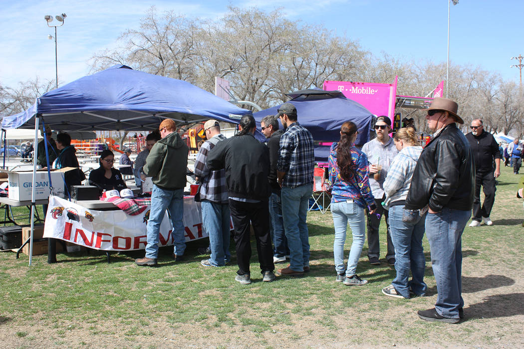 Robin Hebrock/Pahrump Valley Times This file photo shows patrons of the 6th Annual Silver State Chili Cook-off at the information booth where event staffers were selling the tasting tickets and pa ...