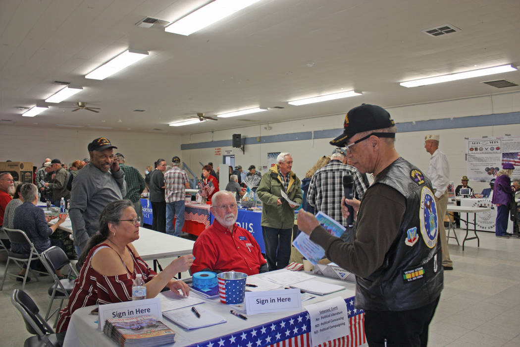 Robin Hebrock/Pahrump Valley Times Veterans Extravaganza volunteers and organizers are shown at the sign-in booth, where veteran attendees were each handed a ticket for free ice cream as well as t ...