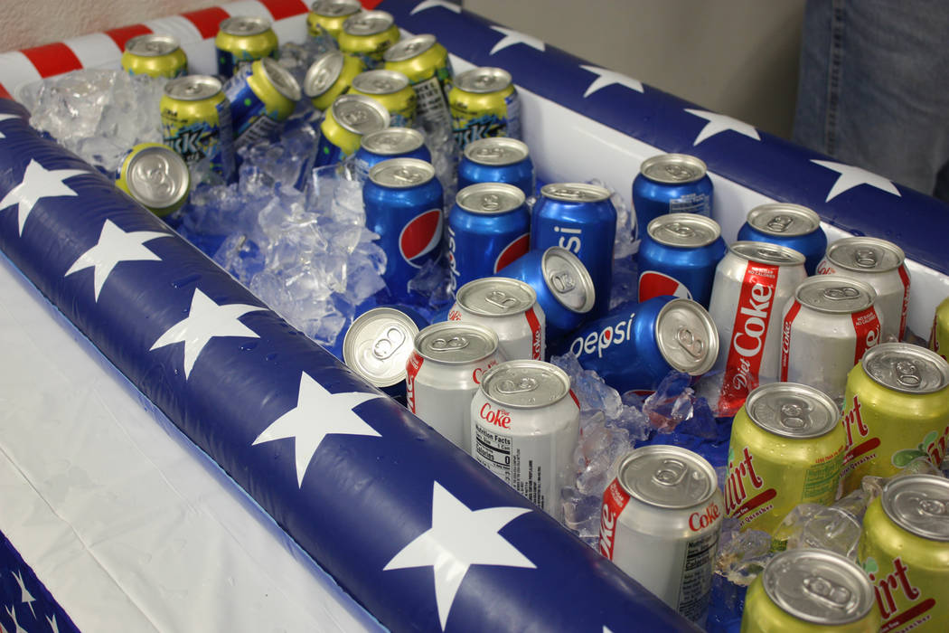 Robin Hebrock/Pahrump Valley Times Conversation can make a person quite thirsty but there was no fear of this occurring at the Veterans Extravaganza, with plenty of drinks provided for all.
