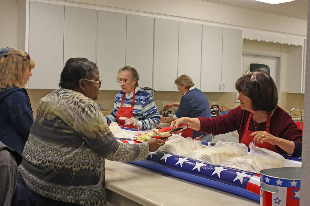 Robin Hebrock/Pahrump Valley Times The Disabled American Veterans Auxiliary prepared a luncheon for Veterans Extravaganza attendees to enjoy, including fruit and sandwiches which attendees were ob ...