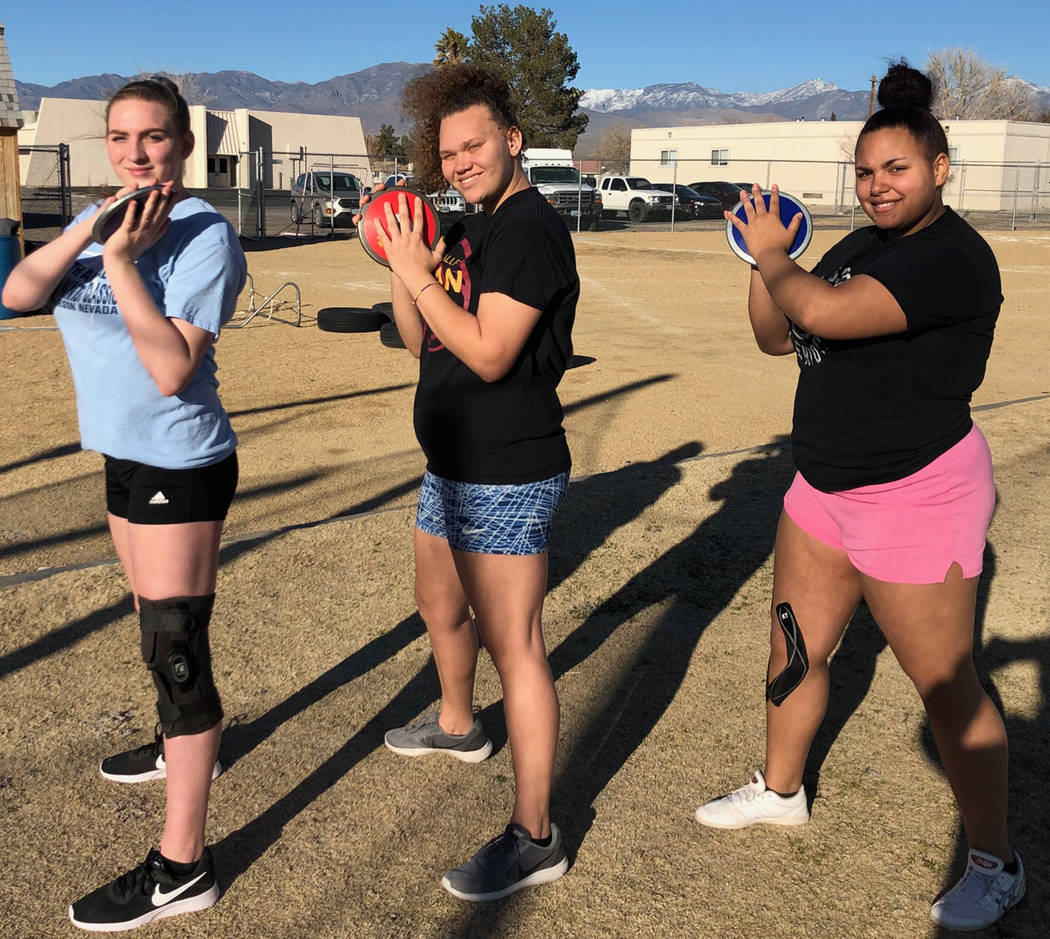 Tom Rysinski/Pahrump Valley Times From left, Pahrump Valley's Kylie Stritenberger, Destany Korschinowski and Quiandra Randolph pose during a preseason track practice at the high school.
