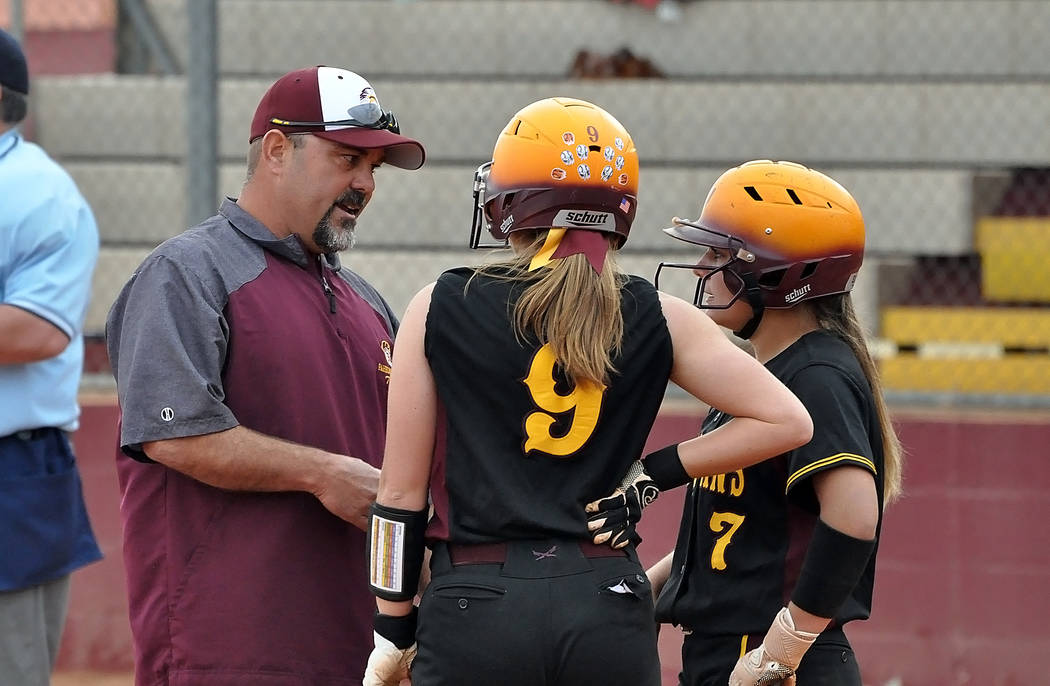 Horace Langford Jr./Pahrump Valley Times Assistant coach Rich Lauver talks with Skyler Lauver (9) and Ally Rily (7) during Pahrump Valley's 14-10 victory over Boulder City on Monday in Pahrump.