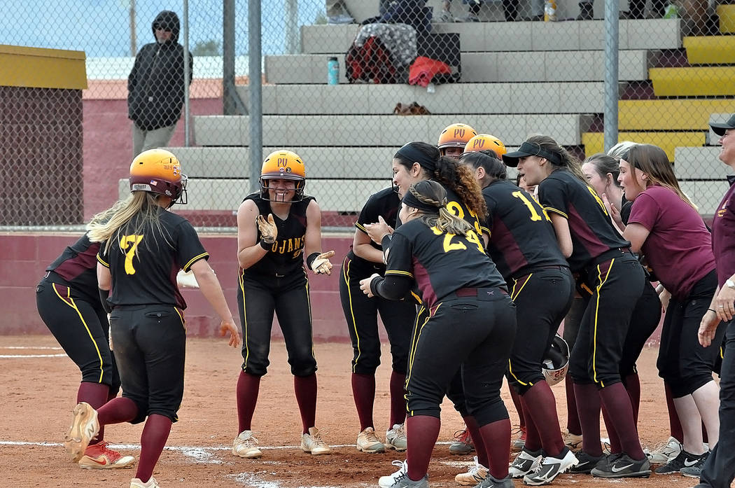 Horace Langford Jr./Pahrump Valley Times The Pahrump Valley softball team waits to greet sophomore Ally Rily at home plate after her 3-run home run in the fifth inning gave the Trojans an 11-9 lea ...