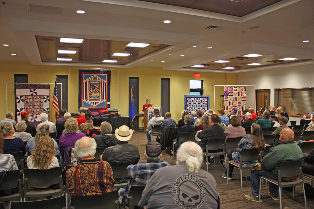 Robin Hebrock/Pahrump Valley Times Nye County Valor Quilters Group Leader Elba Rocha addresses the large crowd gathered for the March presentation ceremony.