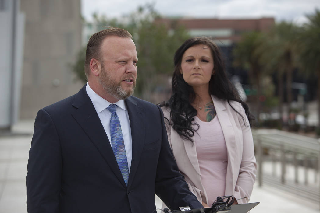 Attorney Jay Ellwanger addresses media alongside his client Jennifer Glover outside the federal court house in Las Vegas, Monday, March 11, 2019. Glover is a former Nevada National Security Site e ...