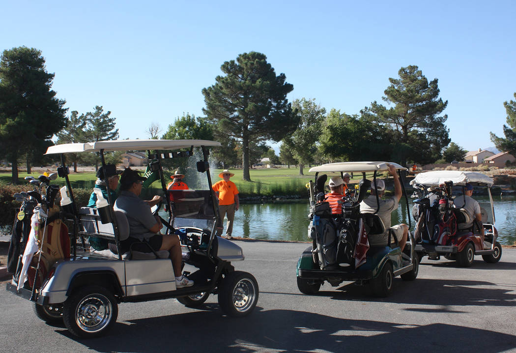 Robin Hebrock/Pahrump Valley Times A parade of golf carts proceed down to their starting positions for the 18-hole scramble-style golf tournament hosted by the Ms. Senior Golden Years and Nevada S ...