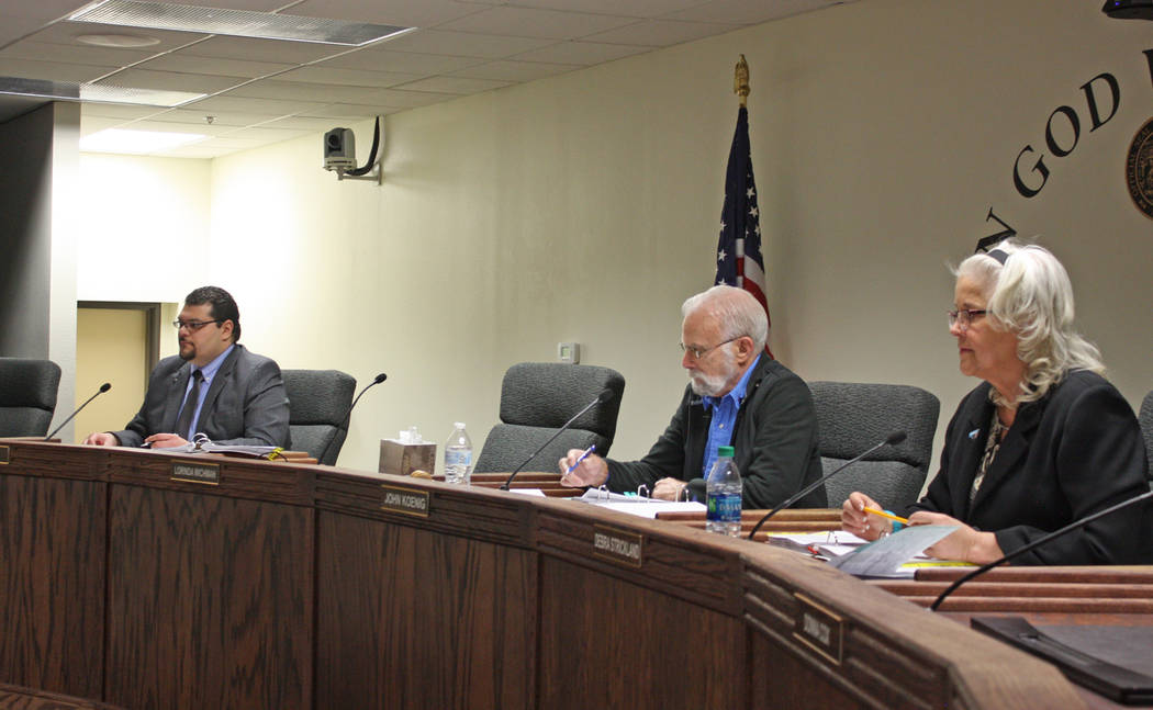 Robin Hebrock/Pahrump Valley Times Nye County Commissioners Leo Blundo, John Koenig and Debra Strickland are pictured at the county commission's March 11 meeting, where the board voted 5-0 to adop ...