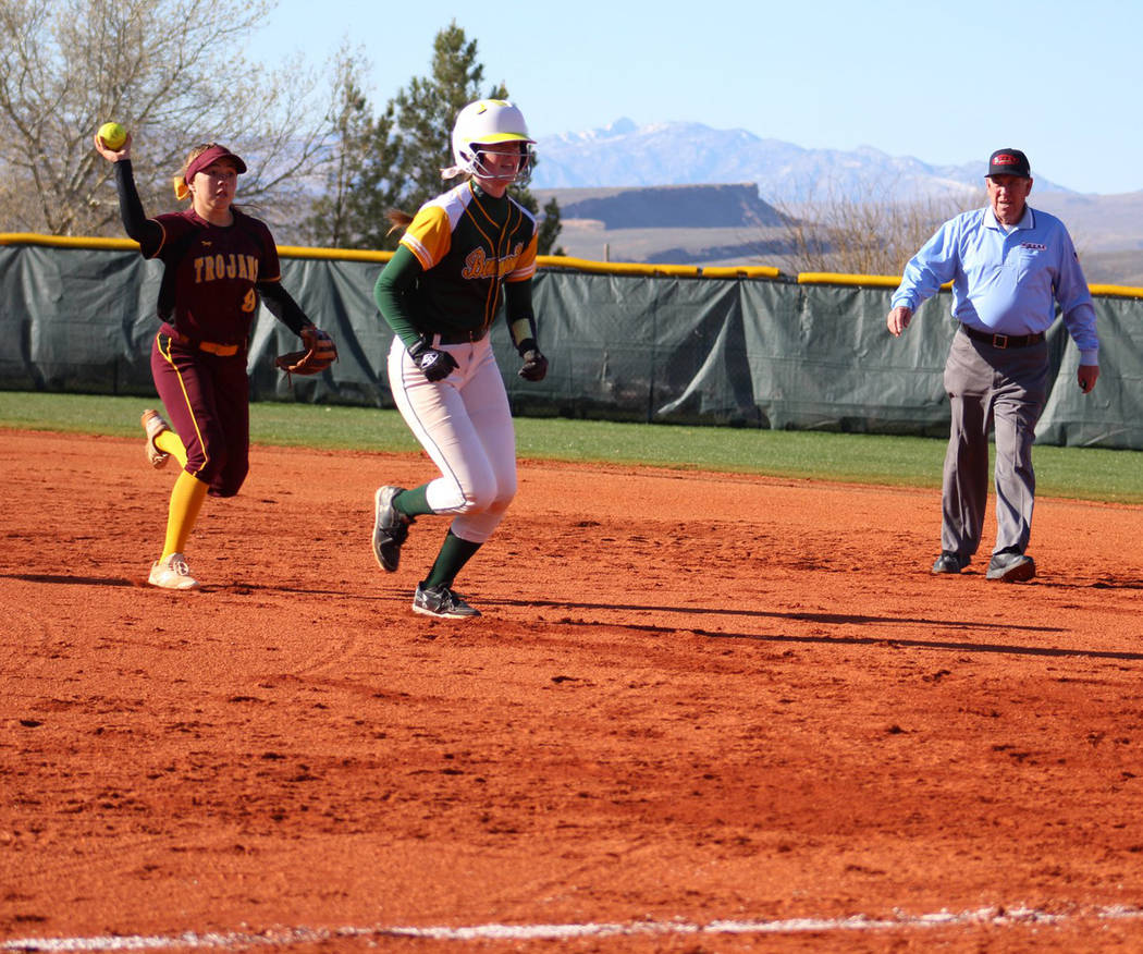 Special to the Pahrump Valley Times Pahrump Valley junior Skyler Lauver chases a Bonneville, Idaho, runner back to first base during the Trojans' 16-6 win over the Bees in the March Warm-Up Tourna ...