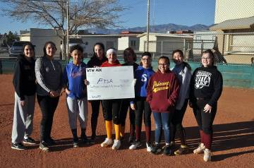 Horace Langford Jr./Pahrump Valley Times Pahrump Youth Softball Association players pose with an oversized check representing $2,755, the proceeds from their Batting 1.000 Classic game earlier thi ...