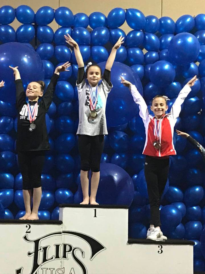 Melissa Plant/Special to the Pahrump Valley Times Arianna Plant, center, on the medal stand after her 9.775 score on the balance beam won her gold at the Nevada State Gymnastics Championships.
