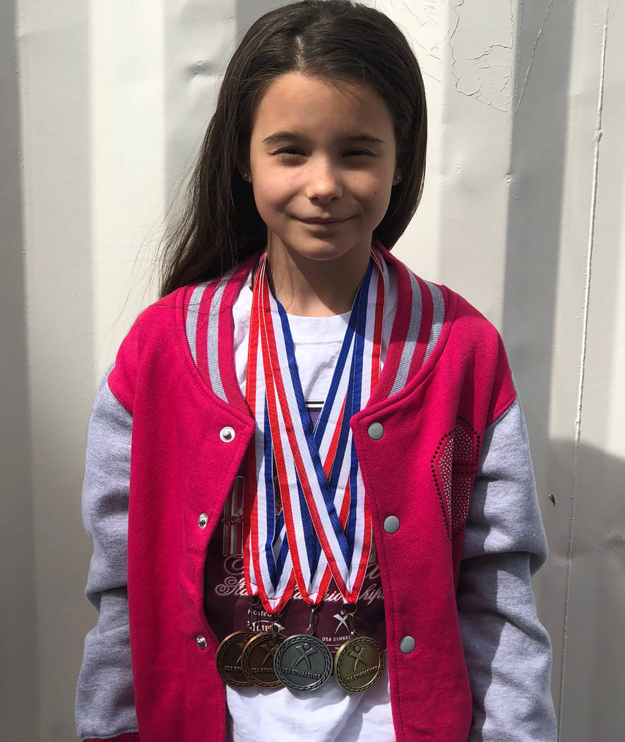 Tom Rysinski/Pahrump Valley Times Arianna Plant, 10, displays the medals she won, including gold in the balance beam, at the Nevada State Gymnastics Championships on March 15-17 in Reno.