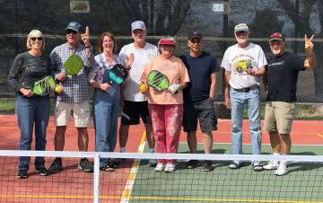 Tom Rysinski/Pahrump Valley Times Pickleball enthusiasts after they finished painting lines for ...
