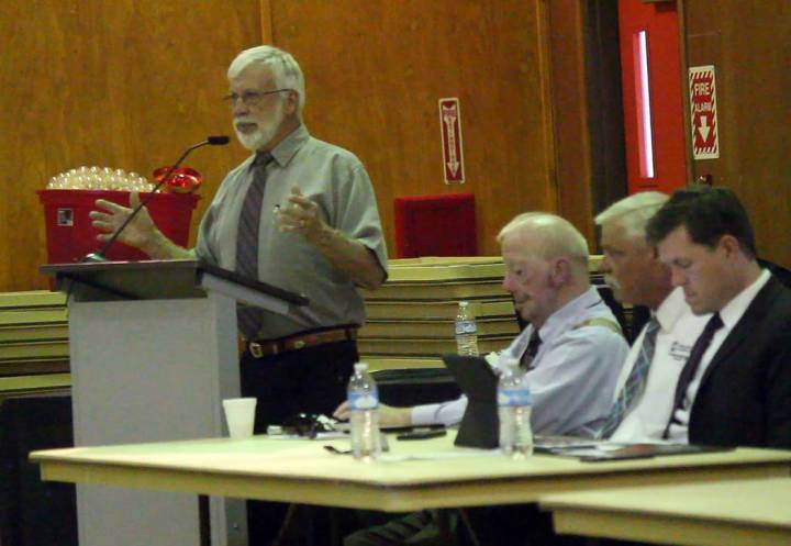 Jeffrey Meehan/Pahrump Valley Times Dave Hall (left), District 2 board of directors for Valley Electric Association, speaks during annual District 2 meeting in Amargosa Valley at 821 E. Amargosa ...