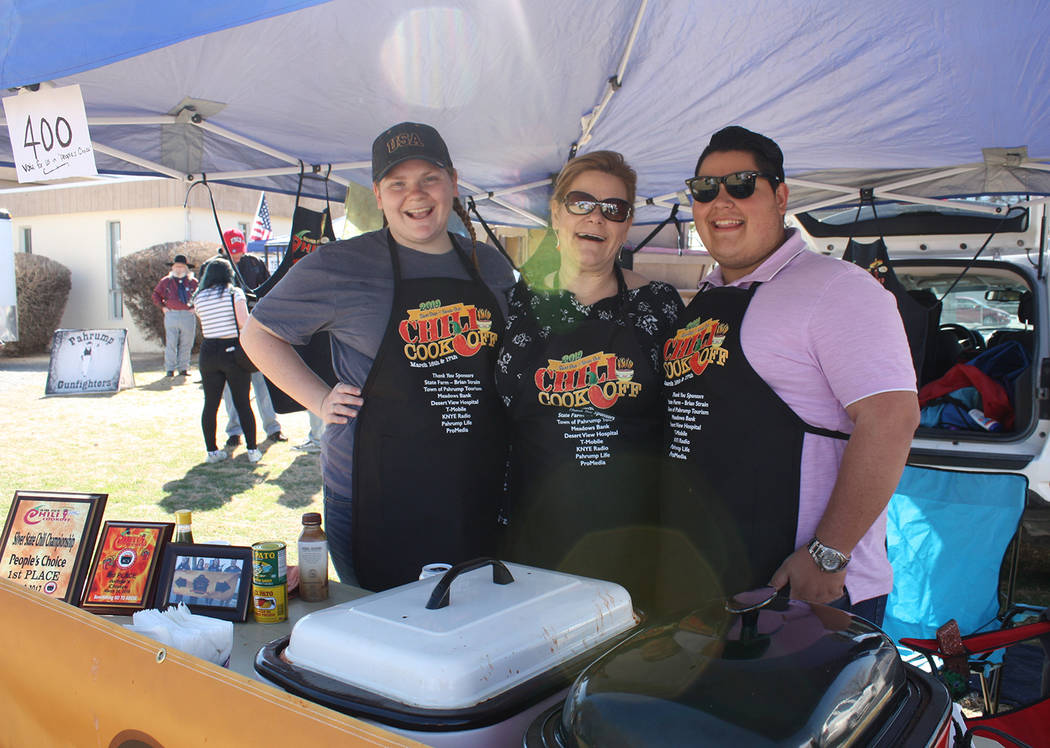 Robin Hebrock/Pahrump Valley Times Darbie O'Donnell, Deanna O'Donnell and Josh Westerman proudly pose for a photo on Saturday, March 16. Their team, Ours is Better Than Theirs Chili Company, took ...
