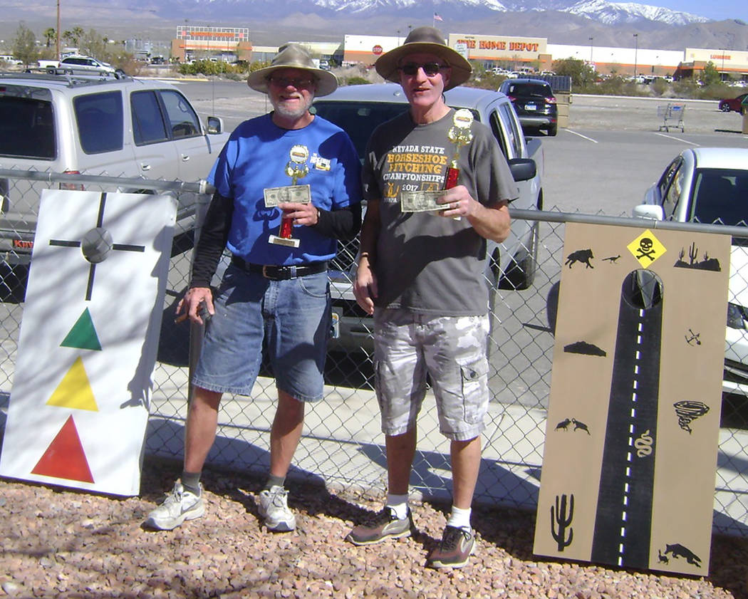 Mike Norton/Special to the Pahrump Valley Times Don Brown, left, and Dan Dunn won the Pahrump Dust Devils' inaugural cornhole tournament Saturday at Petrack Park, pocketing $50 apiece for their ef ...