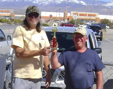 Mike Norton/Special to the Pahrump Valley Times Latham Dilger, left, presents Dave Barefield with the trophy for winning a chili cook-off held during the horseshoes and cornhole tournaments Saturd ...