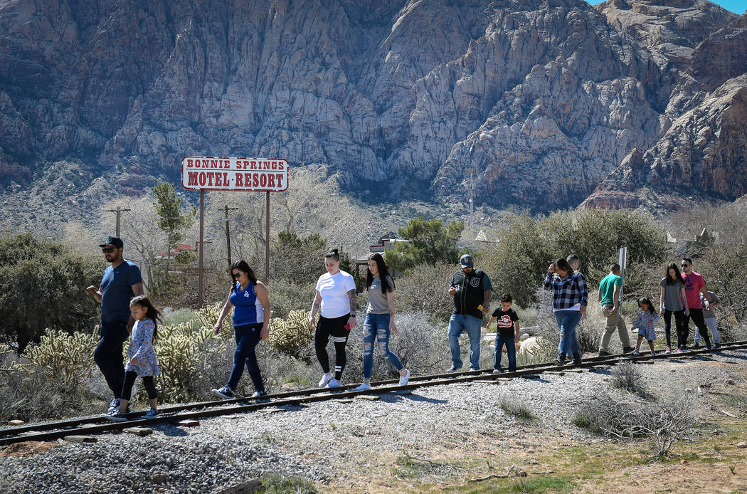 People walk along a train track during the last day of operations at Bonnie Springs Ranch in Las Vegas, Sunday, March 17, 2019. (Caroline Brehman/Las Vegas Review-Journal) @carolinebrehman