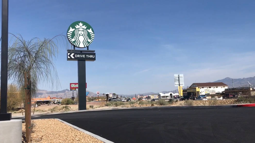 Jeffrey Meehan/Pahrump Valley Times Pahrump's first drive-thru Starbucks location in Pahrump debuted on March 25, 2019. Motorists made their way through the drive-thru line and some took to settin ...