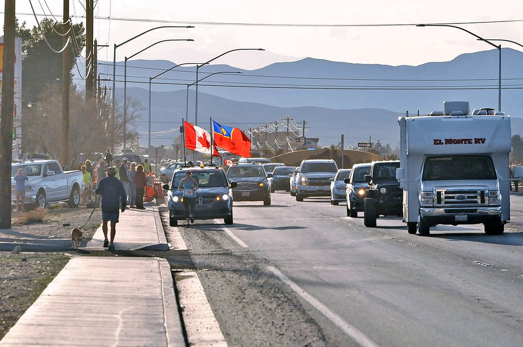 Horace Langford Jr./Pahrump Valley Times A runner with the Women's Royal Canadian Mounted Police is shown running in the Pahrump area on Saturday along Nevada Highway 372 during the Baker to Vega ...