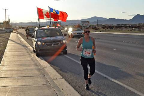 Horace Langford Jr./Pahrump Valley Times A runner representing the Royal Canadian Mounted Polic ...