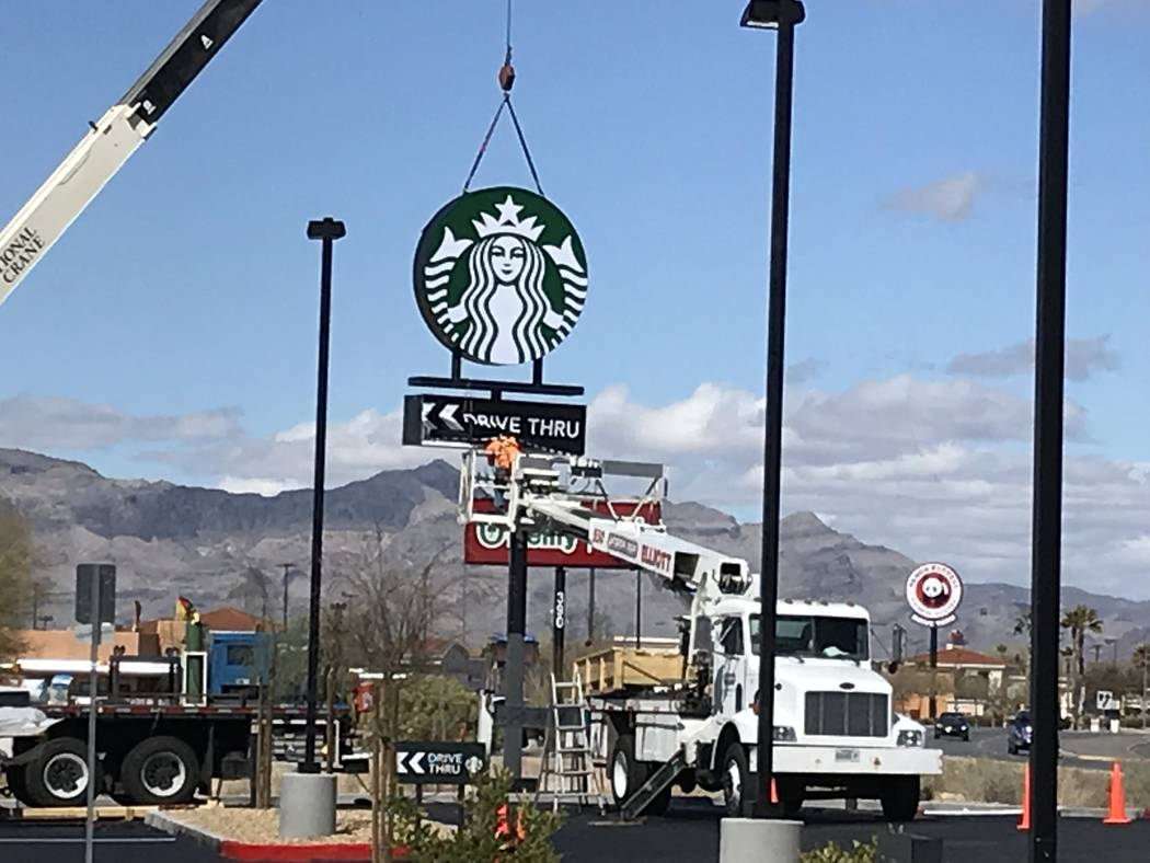 Terri Meehan/Special to the Pahrump Valley Times A sign was raised at the new Starbucks locatio ...
