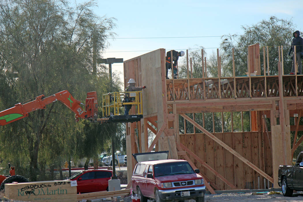 Jeffrey Meehan/Pahrump Valley Times A construction crew works on the future site of a Starbucks ...