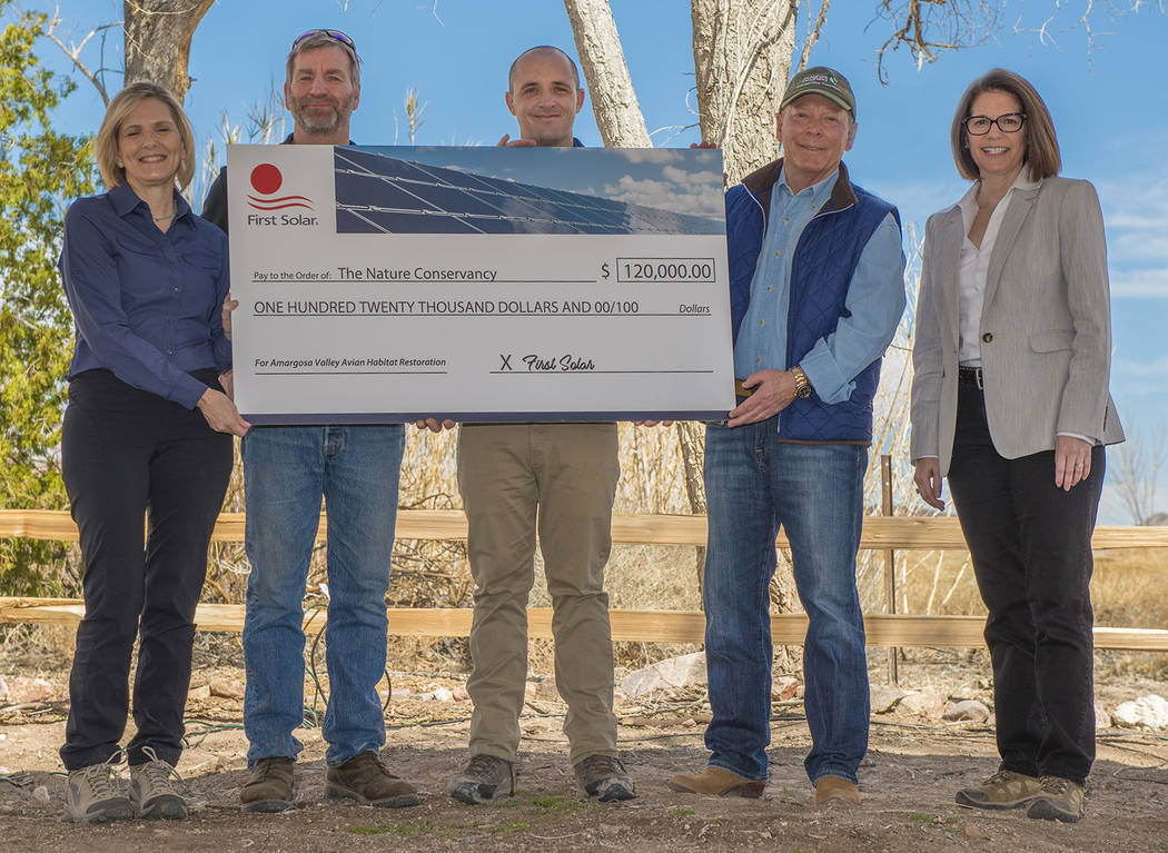 Chip Carroon / Special to the Pahrump Valley Times First Solar presents a check for habitat pr ...