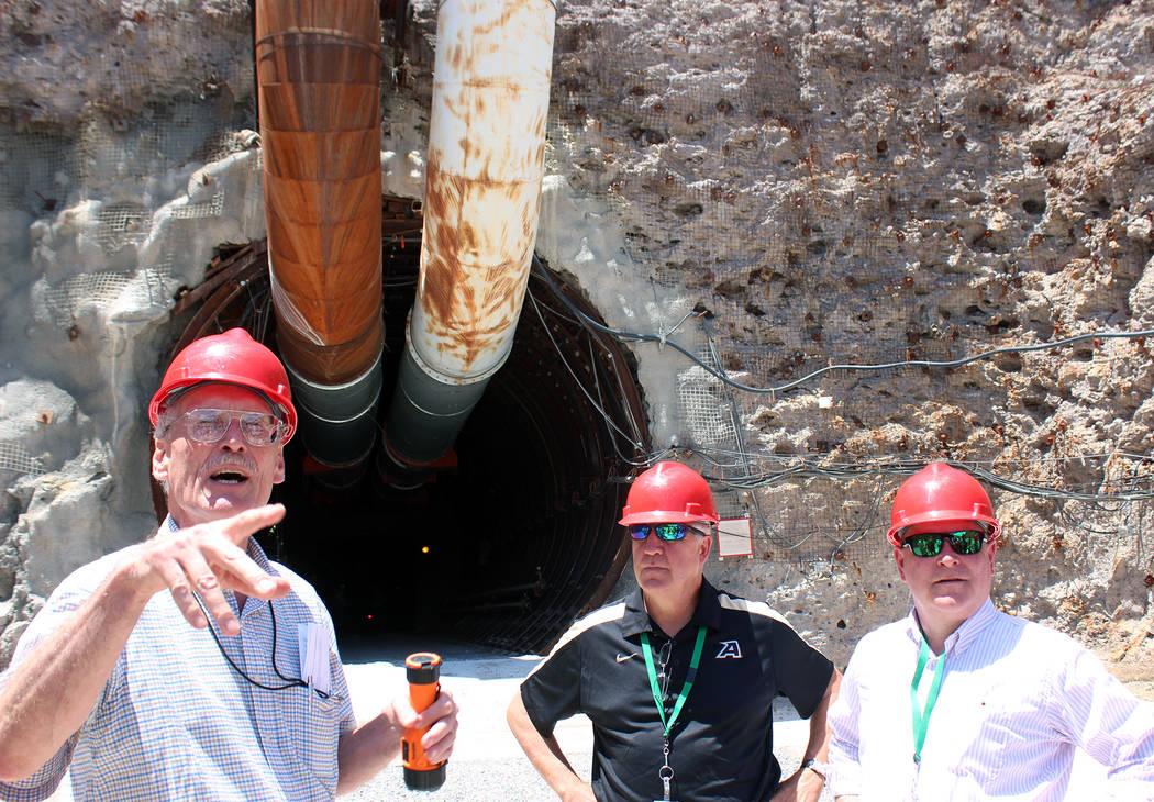 Jeffrey Meehan/Pahrump Valley Times William Boyle, U.S. Department of Energy geologist (left), ...