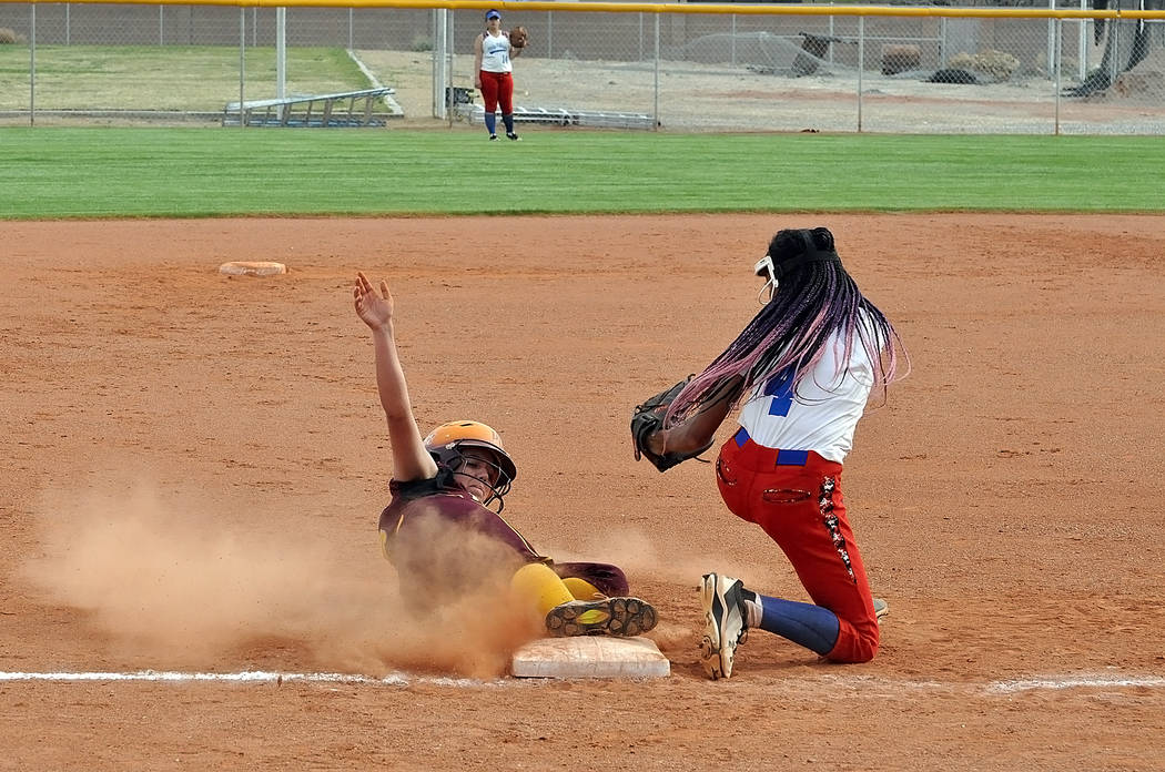 Horace Langford Jr./Pahrump Valley Times Kaden Cable slides safely into third base during Pahru ...