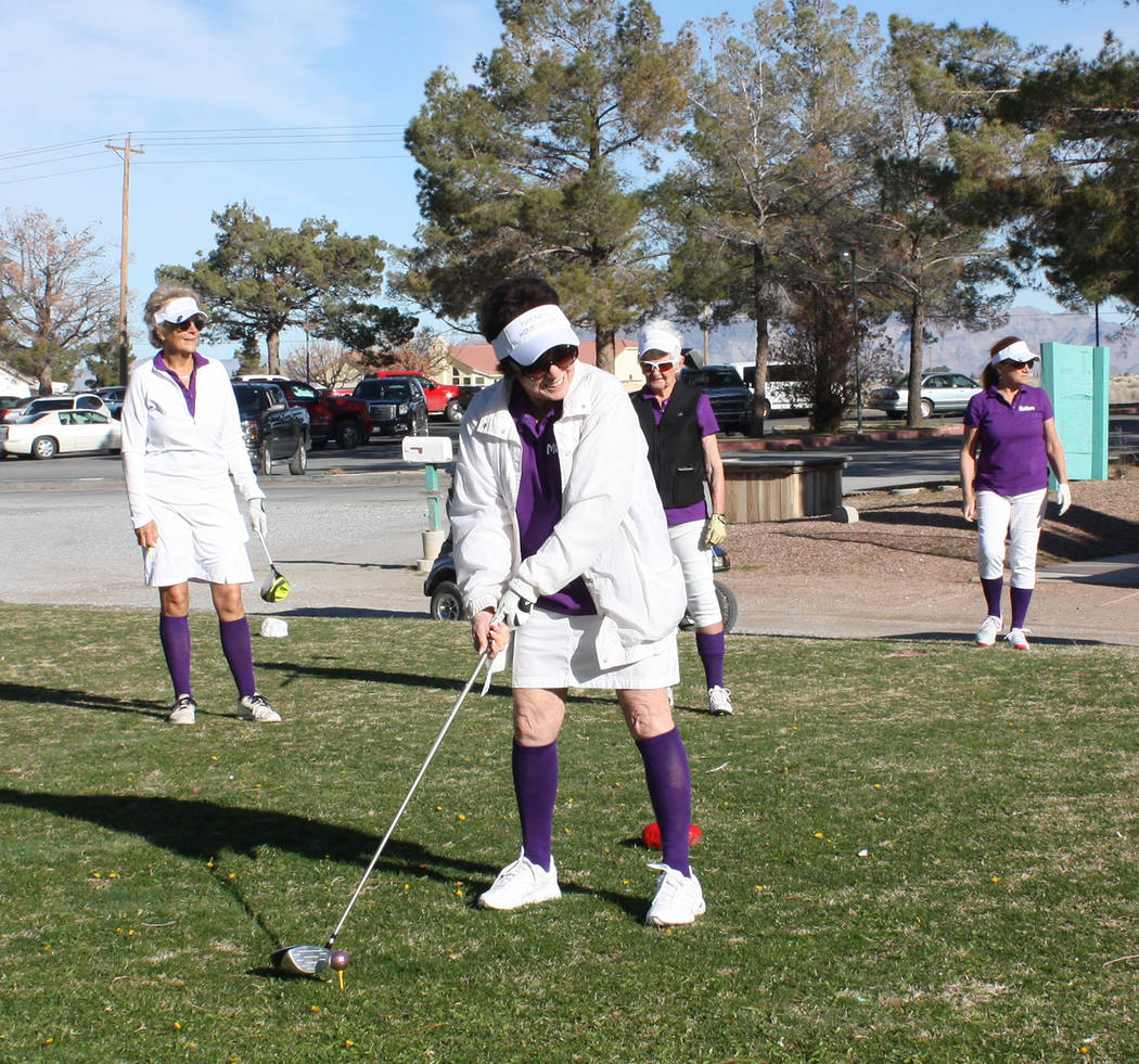 Robin Hebrock/Pahrump Valley Times Marcia Walling prepares to take her first swing in the chari ...