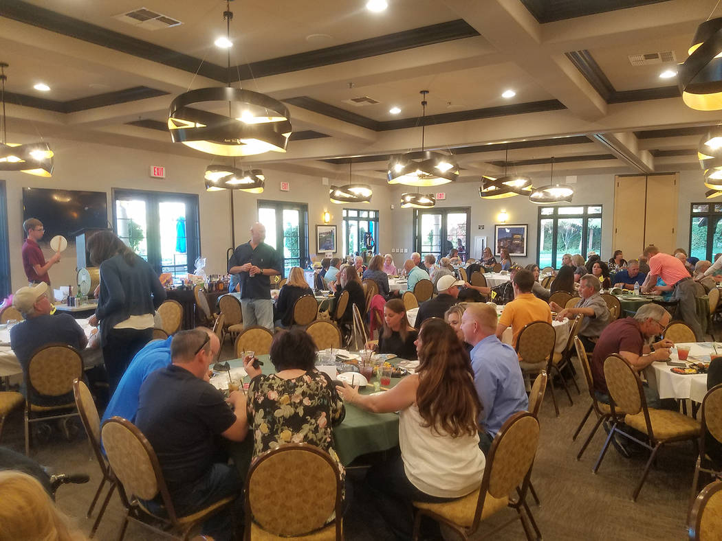 David Jacobs/Pahrump Valley Times The crowd gathers in the Mountain Falls Golf Club Grill Room ...