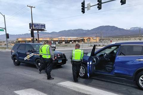 Selwyn Harris/Pahrump Valley Times NHP Troopers await the arrival of a tow truck at the interse ...