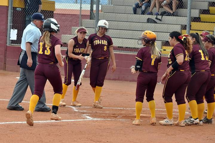 Horace Langford Jr./Pahrump Valley Times Jackie Stobbe is greeted by teammates at home plate af ...