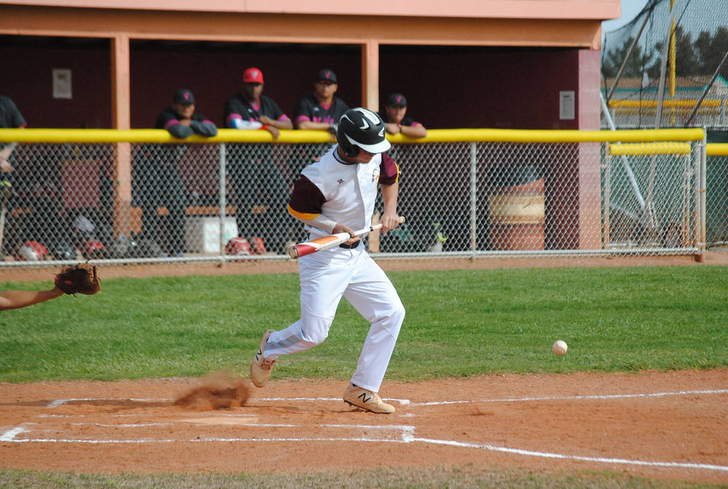 Charlotte Uyeno/Pahrump Valley Times Pahrump Valley senior Tyler Floyd lays down a successful b ...