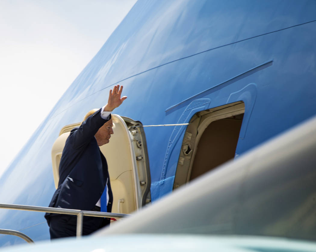 (L.E. Baskow/Las Vegas Review-Journal) @Left_Eye_Images President Donald J. Trump waves as he r ...