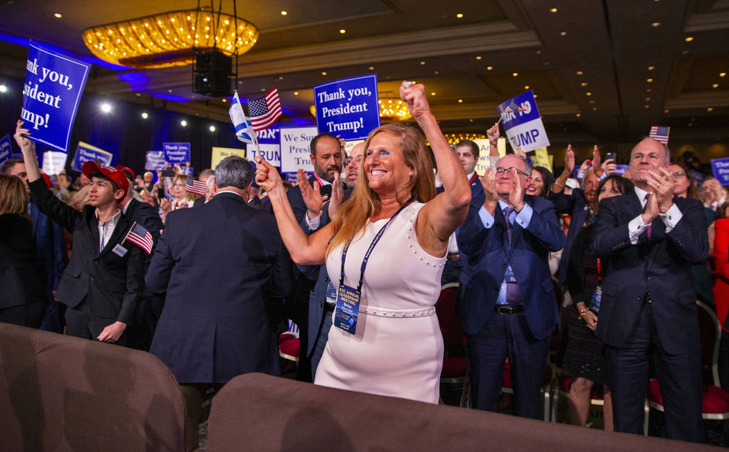 (L.E. Baskow/Las Vegas Review-Journal) @Left_Eye_Images Attendees cheer and applaud as Presiden ...